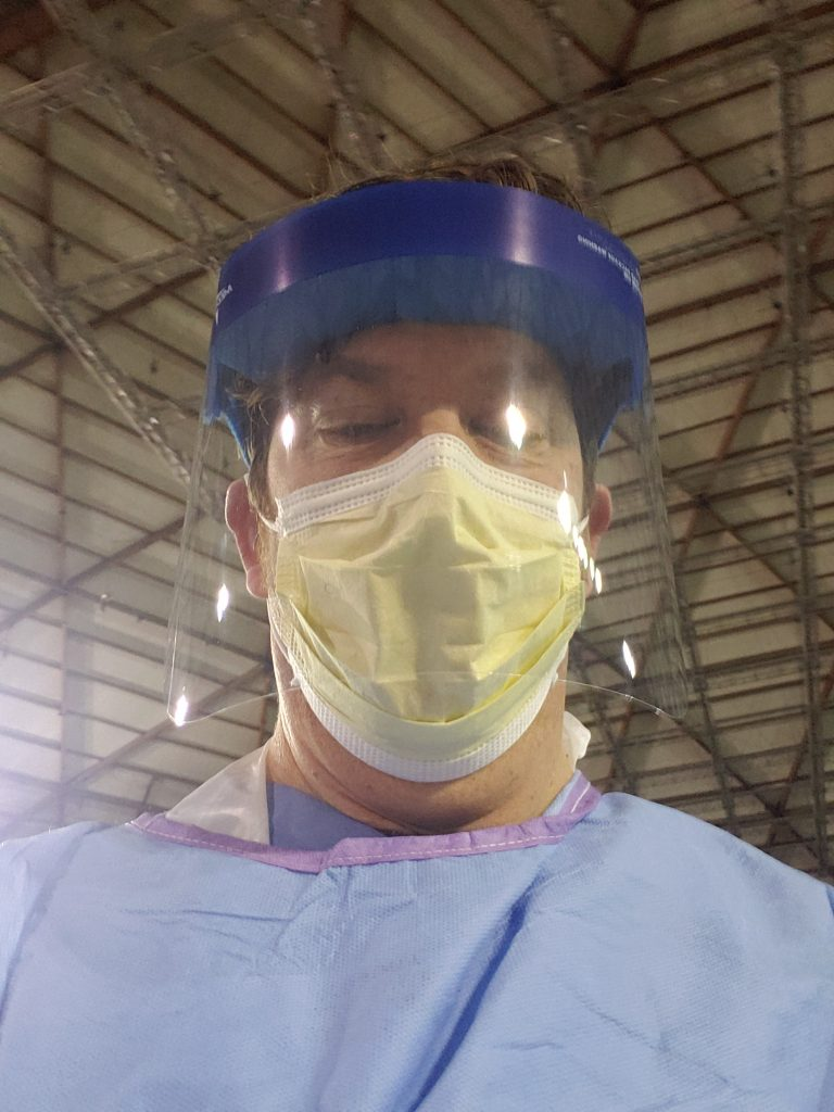 Image of the author, Matthew Brignall ND, in personal protective gear for public health work.
